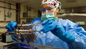 Person holding Surgical Sterilization tools