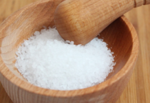 Salt on a wooden bowl