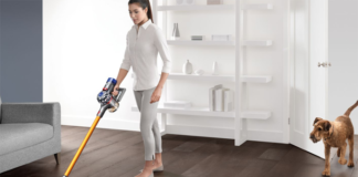 Woman dog and vaccum cleaner